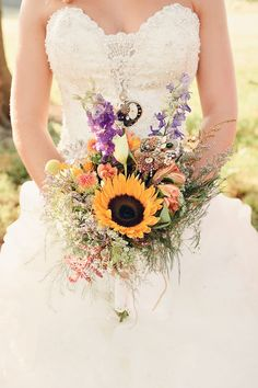 Sunflower as the main attraction in this country/fall bouquet.