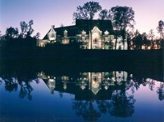 This is a beautiful club house! I really love the colors of the sunset. That lake would be really nice to boat on.