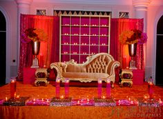 Stage for  indian wedding reception pink and orange decor
