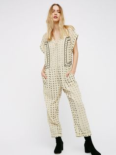 Patch It Up Jumpsuit | All cotton embroidered jumpsuit featuring an ultra relaxed, shapeless fit.    * Front button closures   * Side pockets   * Cuffed sleeves and hem   * Semi-sheer