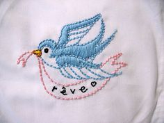 "I embroidered this bird (From Jenny Hart's ""Stitch-It Kit""; Sublime Stitching) onto a white pillowcase.  Took me two nights to make and my fingers are sore; time to get a thimble!  I'm very happy with how this came out!  I embroidered the word ""rêve"" onto it, which translates to ""dream"" from French."