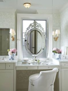Chic bathroom features white washstands flanking drop-down makeup vanity with white marble countertop and white vanity stool and Venetian mirror on ceiling height mirrored backsplash. Vanity Stool, Vanity Set, Vanity Tables, Vanity Ideas, Vanity Fair, Mirror Ideas, Bathroom With Makeup Vanity, Makeup Vanities, Bathroom Vanities