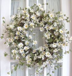 Wedding Ideas: bright-daisy-wreath...........hmm i like wreaths....could make gold sprayed babys breath wreaths in advance......