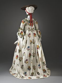 Back view, robe à la Française, France, textile: c. 1750, robe: c. 1760. White linen, embroidered with floral sprays in coloured wool.