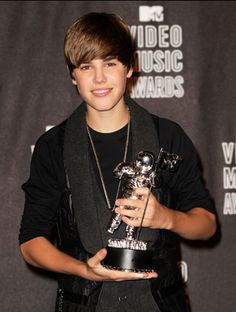 Pop and R sensation Justin Bieber nabs his first ever Moonman after being crowned Best New Artist at the 2010 MTV Video Music Awards.