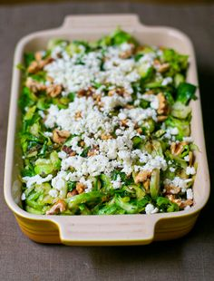 Shaved Brussels Sprouts with Walnuts and Goat Cheese