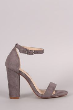 Description This gorgeous heel features an open toe silhouette, one band across vamp, adjustable ankle strap, and chunky heel. Finished with a lightly padded insole for comfort. Material: Vegan Suede