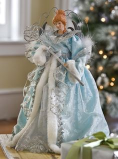 Blue, silver, and white angel Christmas tree topper.