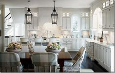 GORGEOUS kitchen!!!  With dual lanterns and Kooboo wicker chairs with plaid slips