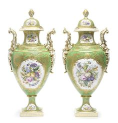 A pair of Coalport vases and covers by William Cook, circa 1850 With crisply modelled rococo handles picked out in gold, painted on both sides with large panels of fruit and flowers by William Cook, smaller panels on the feet and necks, reserved on a green ground within elaborate raised and tooled gilt borders,