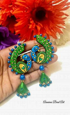 Terracotta peacock earrings from Arunima Bead Art Peacock Jewelry, Peacock Earrings, Clay Earrings, Polymer Clay Jewelry, Handmade Accessories, Handcrafted Jewelry, Teracotta Jewellery, Terracotta Jewellery Designs, Terracotta Earrings