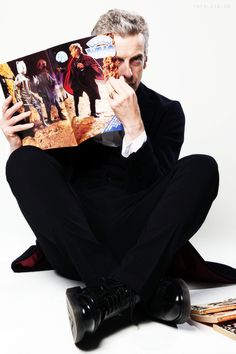 I have the magazine cover he's holding as a framed poster. Awesome. He does remind me of the 3rd Doctor.