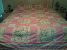 I love this pink and flowering quilt. It was fun making.