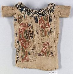 Richly Decorated Tunic, 660–870 A.D. Egypt, Eshmunein.  Tapestry weave in polychrome and undyed wool on plain-weave ground of undyed wool.  Found in Egypt during the Byzantine period and is Coptic in style.