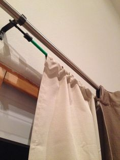Hang two sets of curtains on one rod using this cool trick. Its simple, just hang your blackout curtains on a bungee cord behind your decorative curtains - no one will see the cord and assembly is a breeze! - Home Projects We Love Hanging Curtains, Diy Curtains, Decorative Curtains, Green Curtains, Bedroom Curtains, Diy Blackout Curtains, Roman Curtains, Patterned Curtains, Layered Curtains