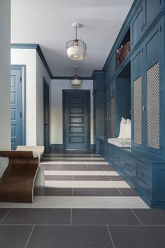 Dark Teal and White Mudroom with Striped Floor