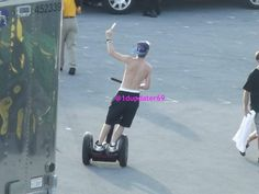 Niall shirtless on a Segway eating a Popsicle Irish Men, Bike, Gym, Sports, Bicycle Kick, Trial Bike, Sport, Bicycle, Work Outs