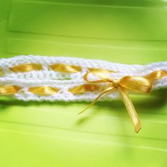 Crocheted baby headband with cute yellow bow!