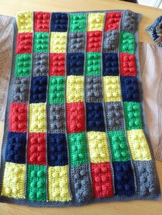 The lego crochet Blanket my mum made! I love it! Everyone comments on it when my sons wrapped in it!