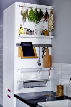 Make the most of every surface by attaching hooks and shelves to maximise storage space - perfect for small kitchens. Interior design ideas and inspiration from HOUSE by House & Garden.