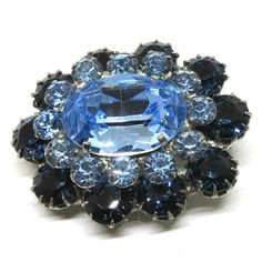 Blue Rhinestone Brooch, Vintage Silver Tone, Faceted Center Stone Pin by MyDellaWear on Etsy