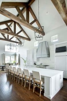 Top 70 Best Vaulted Ceiling Ideas - High Vertical Space Designs From white painted rafters to rustic wood beams, discover the top 70 best vaulted ceiling ideas. Explore bedrooms to living rooms with high vertical space. Kitchen With Long Island, White Kitchen Island, Long Kitchen, Kitchen Island With Seating, Kitchen Islands, Square Island Kitchen, Large Kitchen Island Designs, Island Bench, Kitchen Design