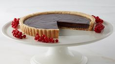 Martha Stewart's chocolate ganache tart recipe appears in the Chocolate Ganache episode of Martha Bakes.