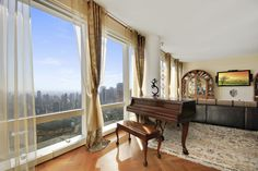 80 Columbus Circle, Apartment 73C: A stunning condo in the sky! Immediately upon entering you are presented with breathtaking panoramic views. The gracious living room and dining room are fronted with 10' floor-to-ceiling windows offering tremendous light and incredible views of Central Park, Columbus Circle, the Hudson River, George Washington Bridge, Statue of Liberty and beyond. Enjoy the most incredible sunrises and sunsets from this 73rd floor.