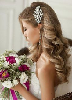 The most popular look among princess brides? Curled locks pinned back with a glam hairpiece.