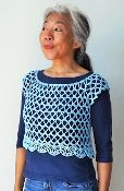 Lattice is a seamless cap shoulder top with a wide neckline design. Doris Chan wrote it for 13 sizes. Crochet it from the neckline down in a simply striking lace stitch pattern.