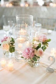 les fleurs : floating candle centerpieces : blush pink : silver table numbers