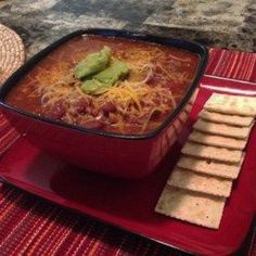 Chipotle peppers add a pleasant smokiness to this bean, beef, and sausage-packed slow cooker chili accented with bacon and chili sauce. Slow Cooker Chili, Slow Cooker Chicken, Slow Cooker Recipes, Crockpot Recipes, Chili Recipes, Mexican Food Recipes, Ethnic Recipes, Copycat Recipes, Chili And Cornbread