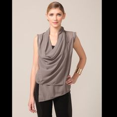 Improv'd Grey Cowl Neck Top Elegant and fashion forward. Grey, draped cowl neck top with leather piping and freyed sleeve hems. Closes in front with zipper. Underneath with button.  Asymmetric from and higher in the back. Adorable with high waisted jeans. Improv'd Tops