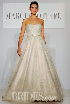 """Brides.com: . """"Hannah"""" strapless embroidered tulle and lace ball gown wedding dress with a sweetheart neckline and silk ribbon belt, Maggie Sottero"""