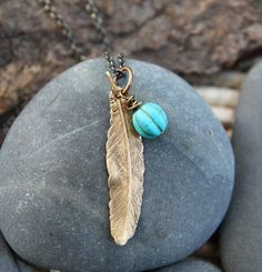 A reminder that you can see that blue sky above you and make the choice to fly. :: turquoise feather love . a so i fly soul mantra necklace