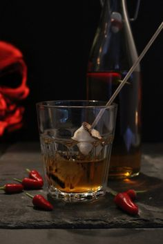 Halloween Cocktails, Halloween Parties. Marshamallow Bourbon is a laced with chilli and stired with a flaming toasted marshmallow stick. Spicy and sweet. Marshamallow Bourbon is a laced with chilli and stired with a flaming toasted marshmallow stick. Spicy and sweet.