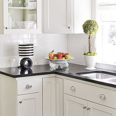 White subway backsplash, black granite, white cabinets. Perhaps they could be laid vertically for a look that's a little more custom.