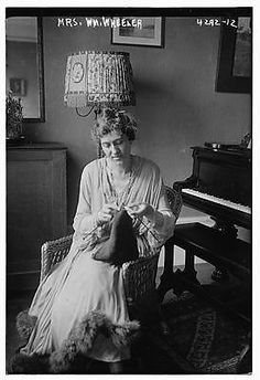 Photo:Mrs. William Wheeler, knitting, piano - husband, William Wheeler, was a Representative from New York and the 19th Vice President of the United States (1877–1881)
