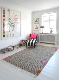 Handwoven rug 'Triangles no. 2' and handwoven cushion cover, designed by kira-cph.com