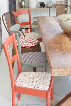 Love the mismatched mix of dining chairs and the paint dipped red chairs.  |  Interior Design by Design Monarchy