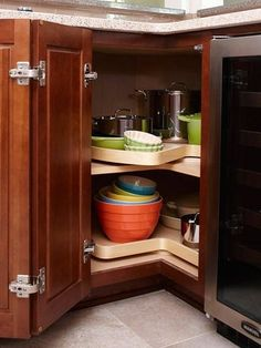 Corner cabinets have to be one of the trickiest areas in a kitchen to figure out. They generally end up having a lot of space, but they aren't very easy to access since the opening is narrow and the cabinet is deep. Luckily, there are a whole host of solutions that can help you make the corner cabinet easy to access and organize. Here are eight of our favorites.