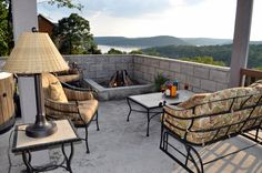 A built in corner fire pit to gather around, and with a lake view