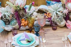 Bohemian tablescape with desert florals and gold flatware