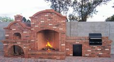 Fireplace pizza oven combo.  Oh man how fun would this be!?!