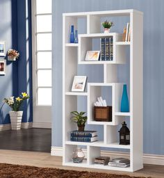 White Modern Bookshelf Coaster Furniture in Bookcases. This Wall Unit by Coaster Furniture can be used to dress up any wall with the look of interlocking shelves, which provide storage and displays space in different sized compartments. Finished in white. White Bookshelves, Modern Bookshelf, Cube Bookcase, Bookshelf Design, Bookcase Storage, Shelving, Bookcases, Ladder Bookcase, Office Storage