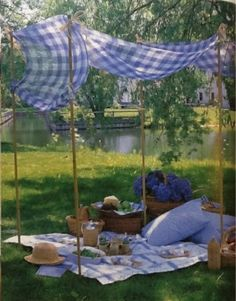 a simple canopy on metal rods (so that you can stick them to ground), a couple of pillows...