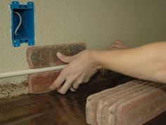 How to Install a Brick Backsplash in a Kitchen : How-To : DIY Network Step by step instructions with photos. With assistance for the tile saw, seems like it would be a breeze to do yourself!