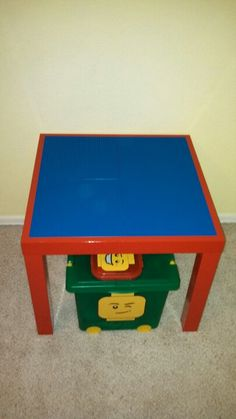 Thank you, Pinterest, for the idea! Ikea Lack table in Gloss Red = $12.99, 4 blue Lego base plates = $4.99/ea. Attach base plates with gorilla glue and be sure to use only a tiny bit & leave some space from the edges because the glue expands. The entire project cost less than $40. It could've been cheaper if I'd used the most basic Ikea Lack table as it is just $7.99; however, I wanted red & blue to match Evan's Super Mario Bros. themed bedroom. Lego Base Plates, Ikea Lack Table, Lego Room, Bedroom Themes, Kids Bedroom, Ikea Ideas, Love My Kids, Small Places, Mario Bros