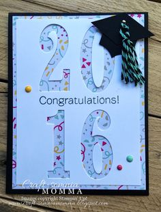 Use large die cut numbers on a white panel and back it with fun designer paper. Add cap, tassel and enamel dots to this handmade graduation card.