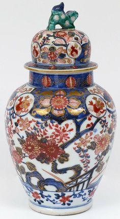 "Japanese. Meiji-Period. Late 19th Century. Decorated with iron red and underglazed blue enamels. Height 10 1/4""."